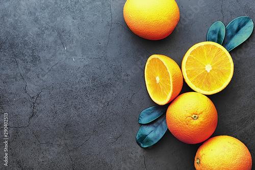 Obraz na plátně  Orange citrus fruit on a stone table. Orange background.