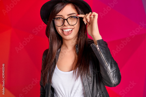 Trendy young woman showing tongue