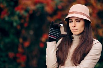 Woman Using Asthma Inhaler in Autumn Season