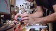 Worker adjusting wiring on robotics circuit boards