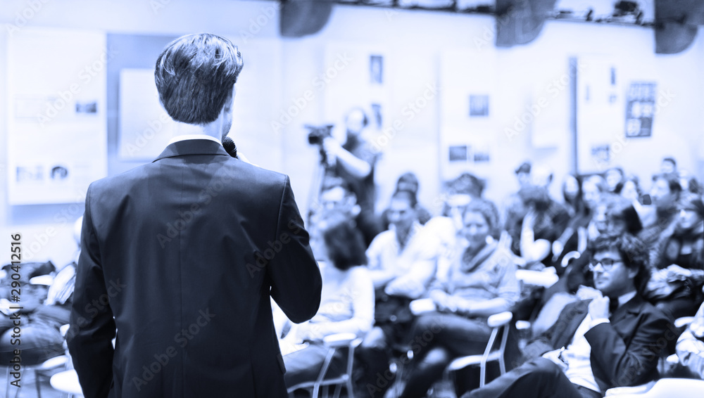 Fototapeta Speaker Giving a Talk at Business Meeting. Audience in the conference hall. Business and Entrepreneurship. Copy space on white board.