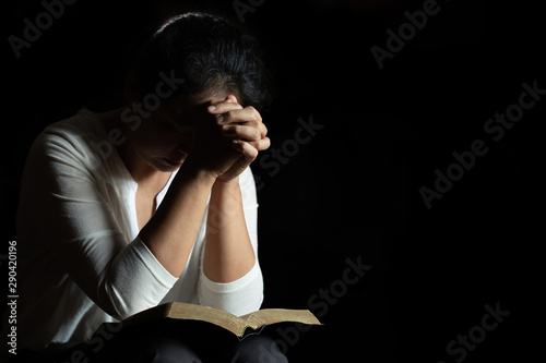 Spirituality and religion, Hands folded in prayer on a Holy Bible in church concept for faith Wallpaper Mural