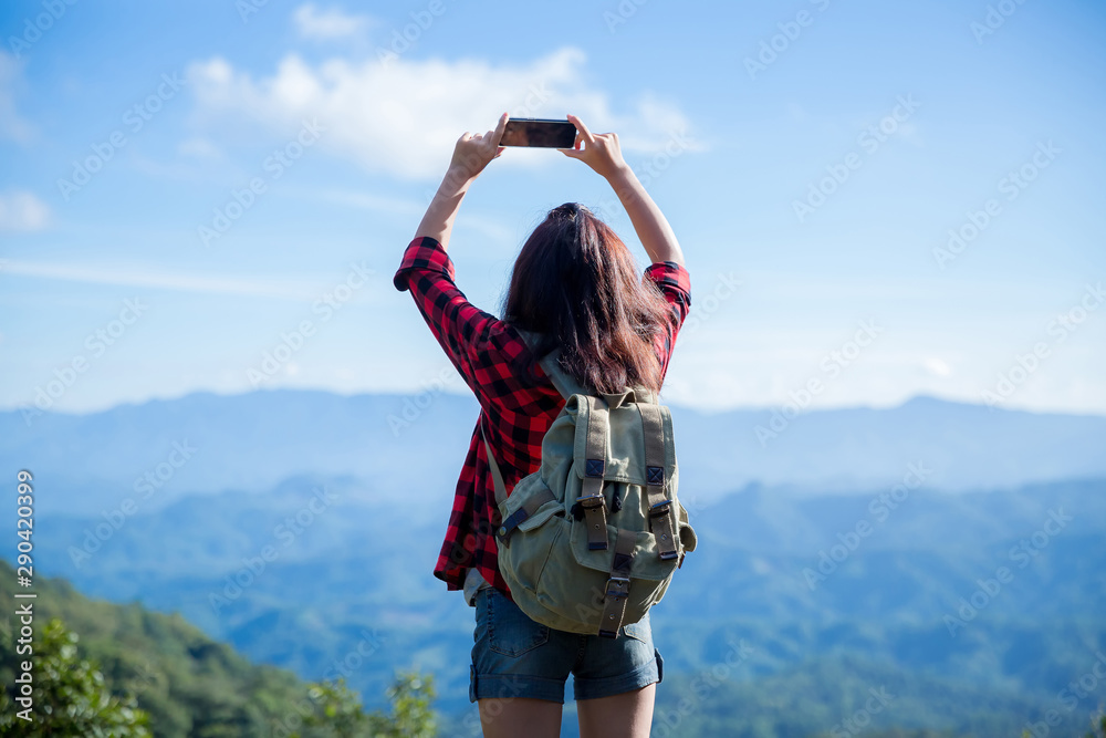 Fototapety, obrazy: Travelers, young women, look at the amazing mountains and forests, wanderlust travel ideas,