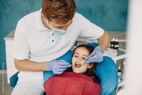 Lovely little girl doing teeth examination at a pediatric stomatology.