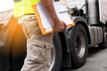 Truck Driver Hand Holding Clipboard Inspecting Safety Daily Check Before Driving A Truck.