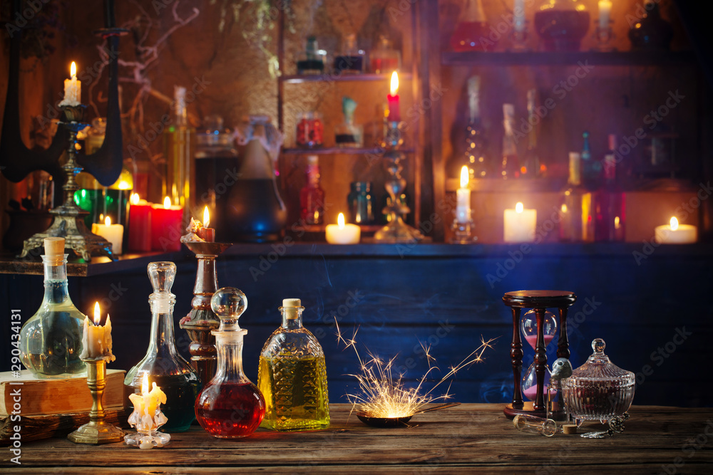 Fototapeta magic potions in bottles on wooden background