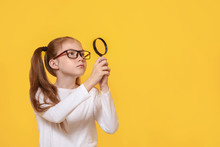 Little Girl With Magnifying Glass On Color Background