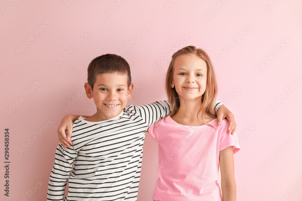 Fototapeta Portrait of happy little children on color background