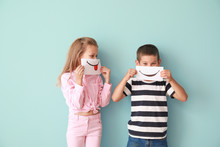 Little Children Hiding Mouths Behind Drawn Smiles On Color Background