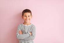 Portrait Of Happy Little Boy On Color Background