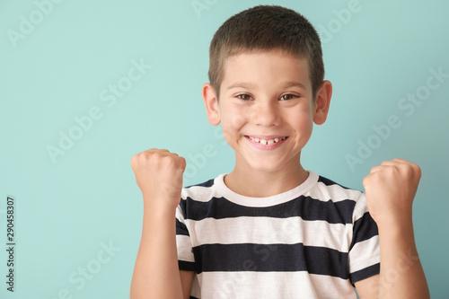 Obraz Portrait of happy little boy on color background - fototapety do salonu