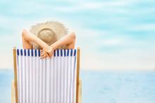 Woman Relaxing On Sea Beach