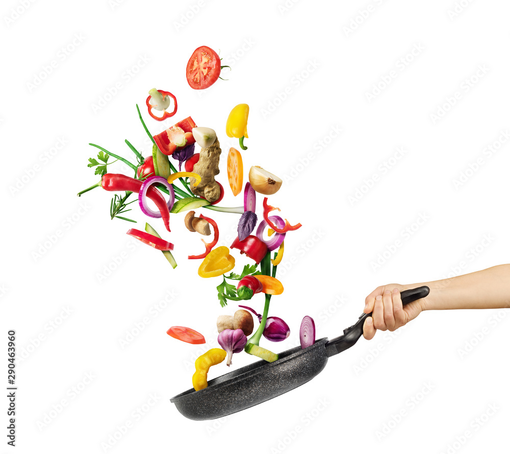 Fototapety, obrazy: Cooking concept. Vegetables are flying out of the pan isolated on white background. Healthy food.