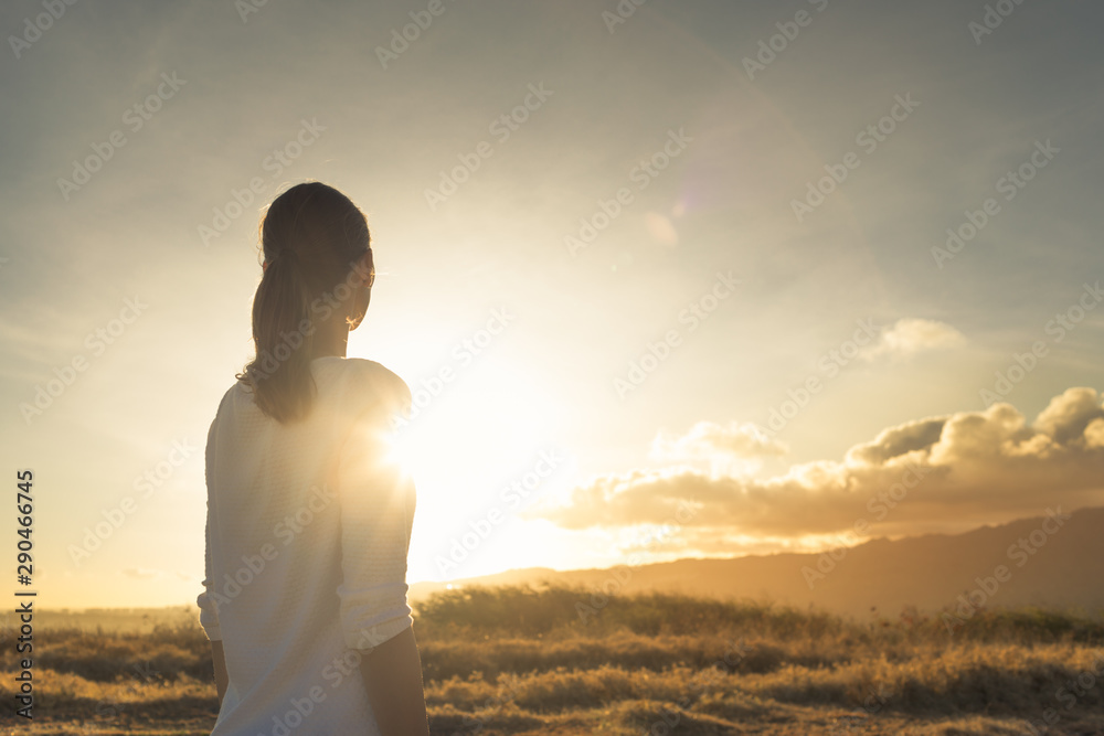 Fototapety, obrazy: Looking to the future, new day, new beginning. Young female standing on a mountain facing sunset.