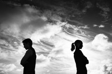 Silhouette Of Upset Man And Wo...