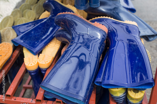 Photo Pair of blue rubber boots