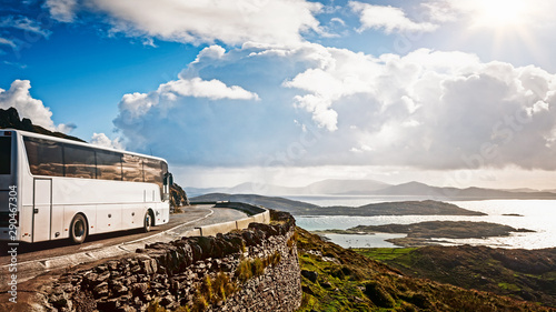 White tourist bus traveling Canvas Print