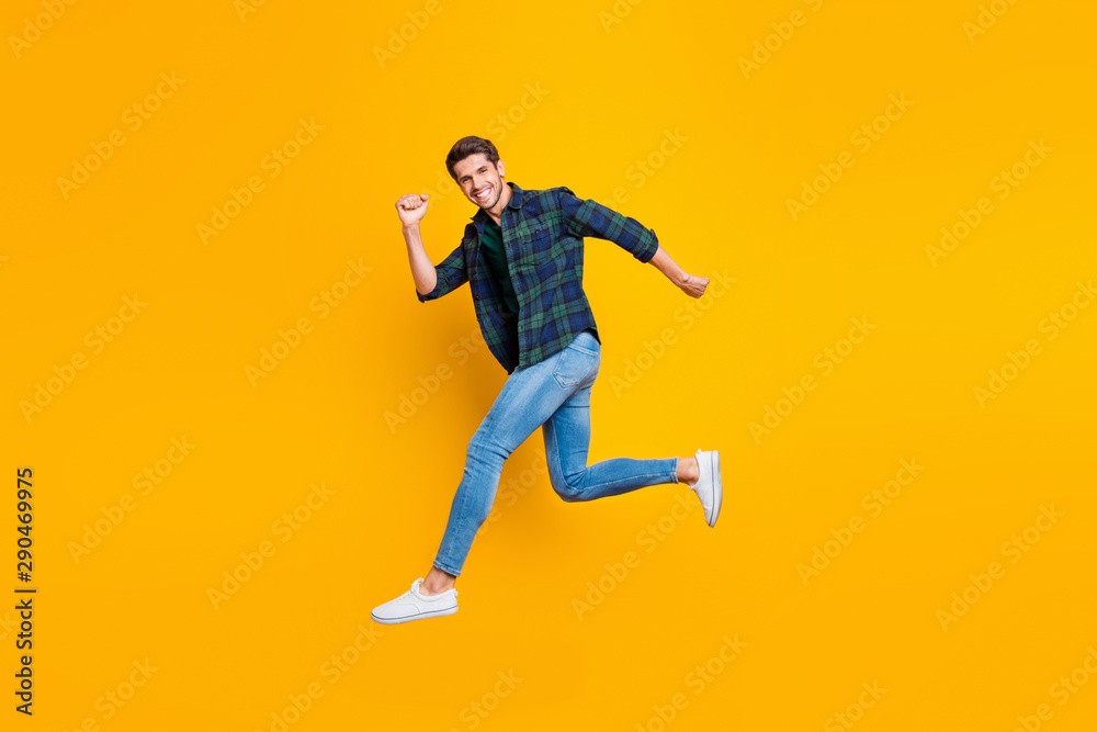 Fototapety, obrazy: Full length body size photo of cheerful attractive handsome guy going jumping somewhere trendy wearing jeans denim isolated over vivid color background