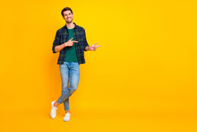 Copyspace Full Length Body Size Photo Of Cheerful Handsome Guy Wearing Denim Jeans Checkered Shirt Footwear Asking You To Glance At Empty Space Isolated Over Vibrant Color Background