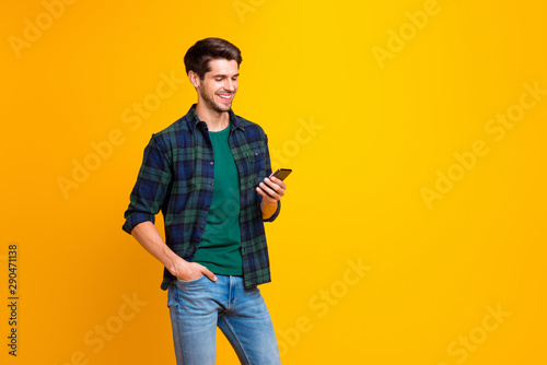 Photo of blogger guy holding telephone in hands checking subscribers wear casual Slika na platnu