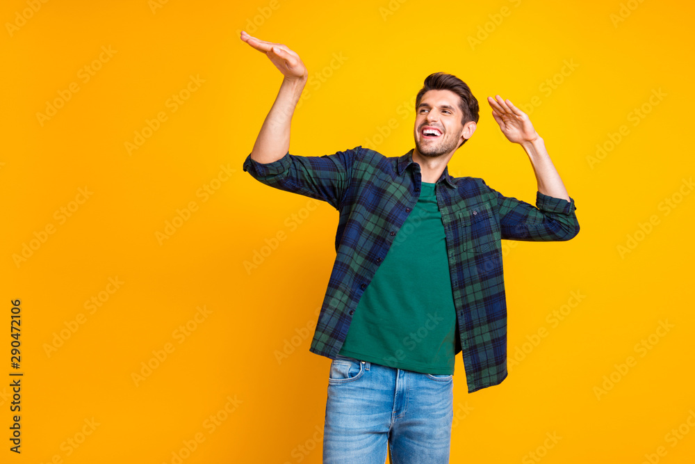 Fototapety, obrazy: Photo of nice guy crazy dancer inviting friends to dance floor wear casual plaid shirt isolated yellow color background