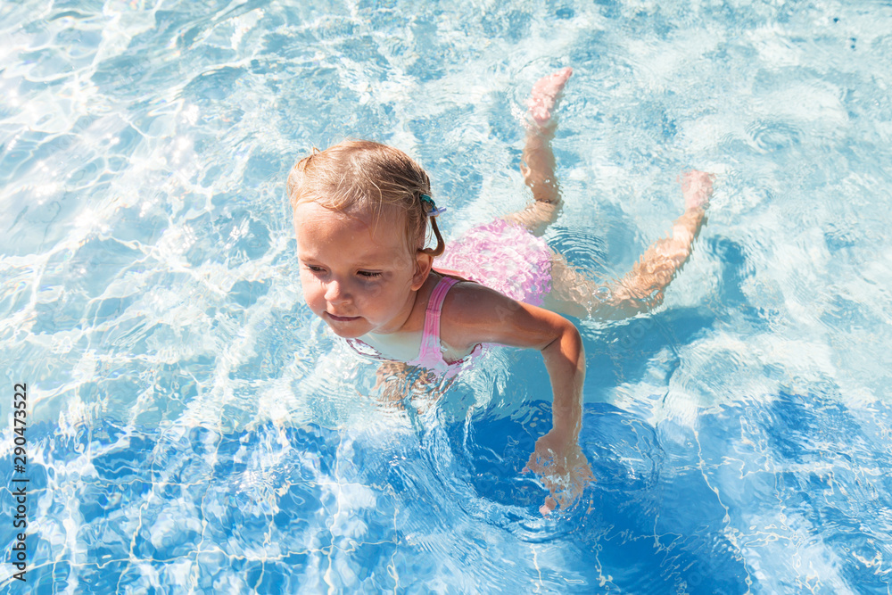 Fototapety, obrazy: Little girl swimming in the pool on summer holidays