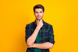 Photo of amazing macho guy thinking about important business decision wear casual plaid shirt isolated yellow color background - 290474594