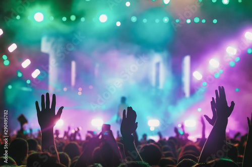 People taking photographs with touch smart phone during a music entertainment public concert - 290495782