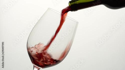 Obraz na plátně  pouring red wine in a glass
