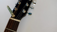 Guitar Headstock With Tuning Pegs  And Dollar . Color Background . Closeup