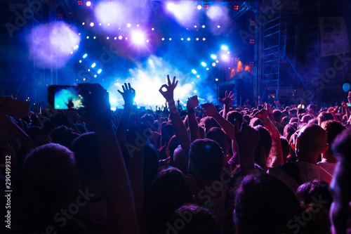People taking photographs with touch smart phone during a music entertainment public concert - 290499312