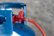 Rusty Pressure Regulator And Operating Valve Of Cooking Gas Tanks. LPG . Hose Connect To The Cylinder Red Gas Supply.