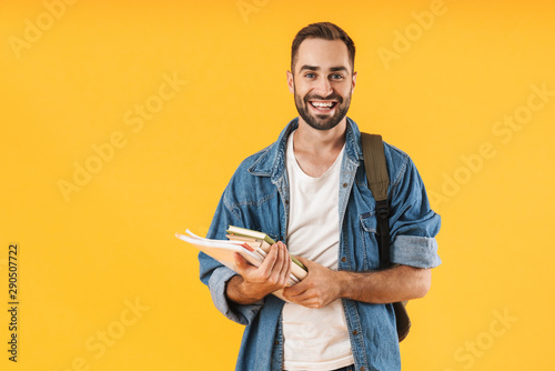 Fotografia Image of content student guy smiling while holding exercise books