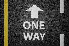 One Way Sign On Asphalt Ground
