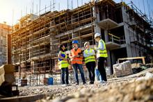 Four Construction Workers Havi...