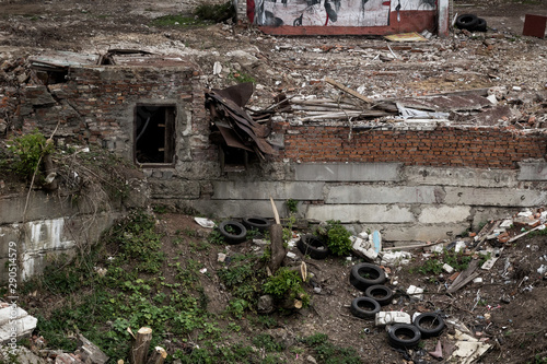 Old collapsed building polluted by garbage and car tires Canvas Print