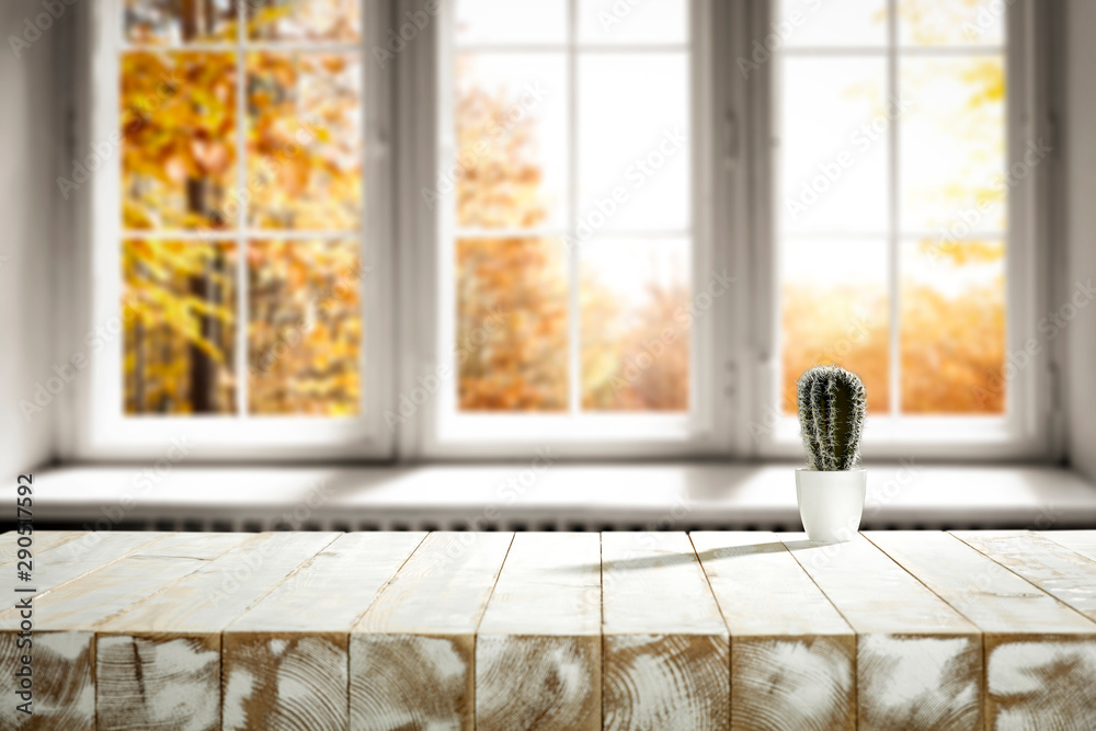 Fototapeta White wooden table of free space for your decoration and autumn time.