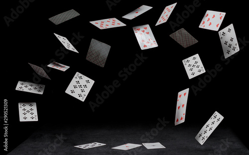 playing cards fall on a black table Canvas Print