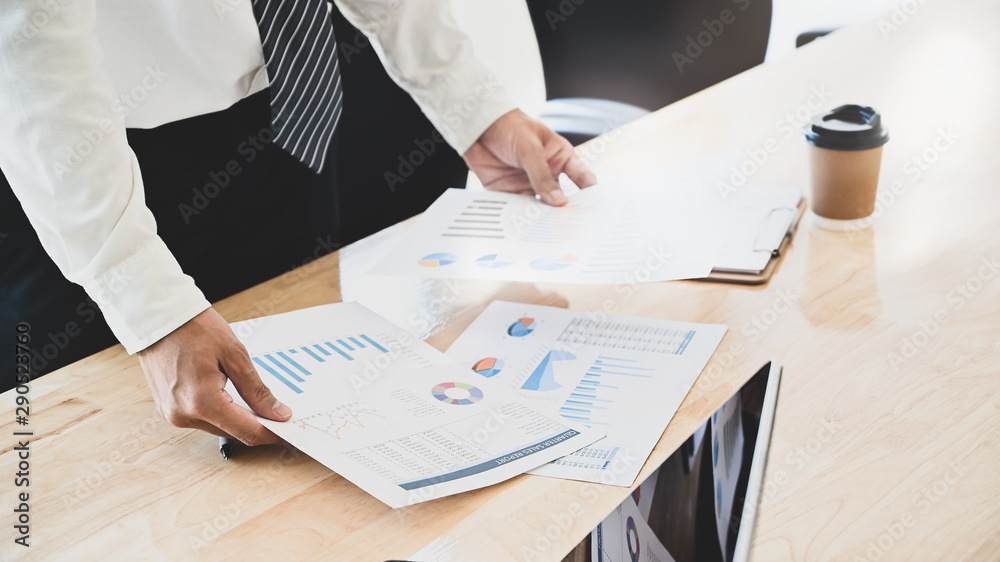 Fototapety, obrazy: Businessman compare finance data on table.