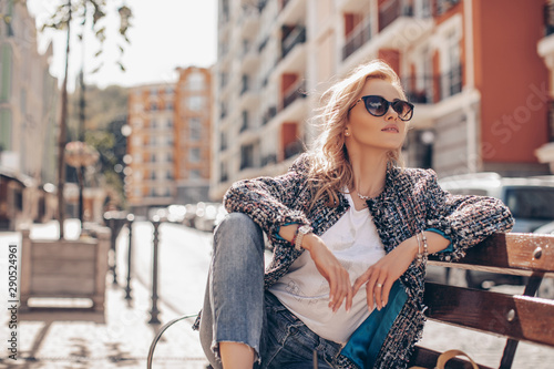 obraz lub plakat happy girl for a walk in the sunny city .