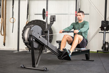 Man Using Rowing Machine In A Gym