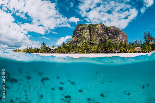 Tropical crystal ocean with Le Morne mountain and luxury beach in Mauritius. Split view. - 290541941