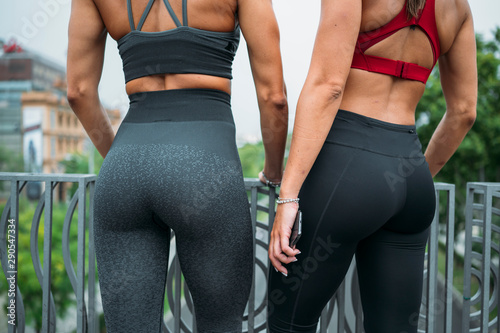 Closeup view of young woman bums with sport outfit Canvas Print