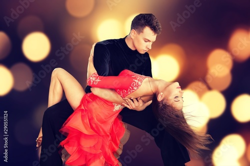 Fotomural Man and a woman dancing Salsa on background