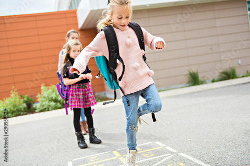 A Hopscotch on the schoolyard with friends play together Fototapeta
