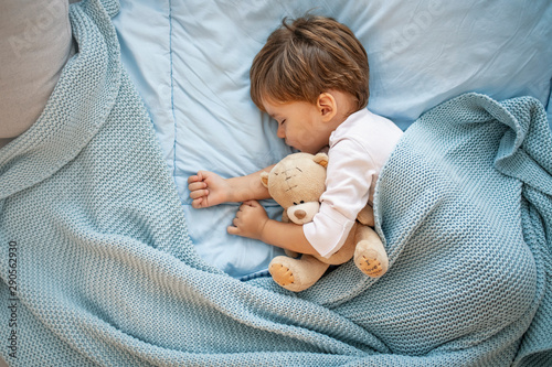 Sweet little boy sleeps with a toy Wallpaper Mural