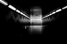 A Man Walking Up The Stairs From A Subway Tunnel.