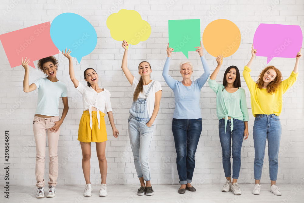 Fototapeta Diverse Women Holding Colorful Speech Bubbles Next To White Wall