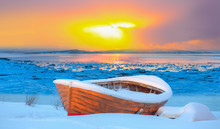 Red Wooden Boat Covered With Layers Of Snow - Beautiful Winter Landscape With Snow Covered Green House - Tromso, Norway