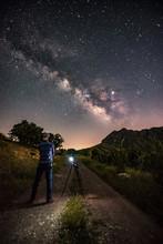 Man Looks At Expanse Of Stars